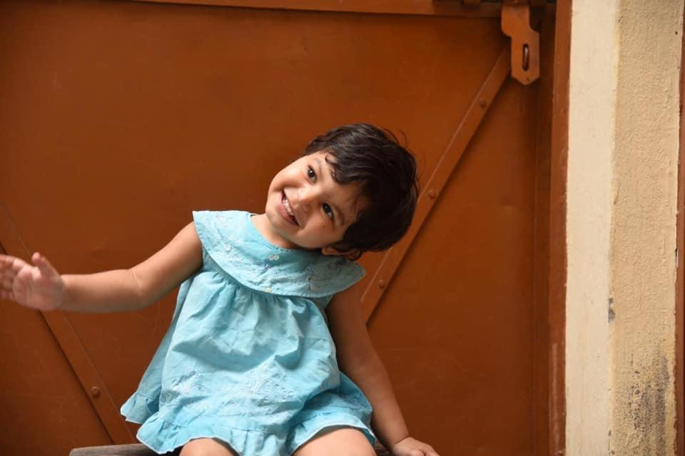 My cute niece, smiling.